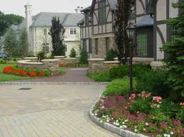 modern front yard landscaping walkway paving stone borders white