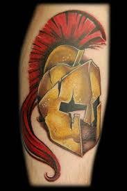 bronze spartan helmet tattoo on arm tattoomagz