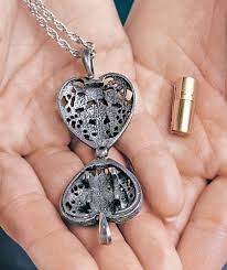 necklaces that hold ashes cathedral paw print memorial ashes locket necklace pewter