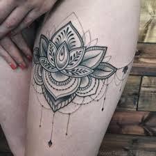 82 superb flower tattoos on thigh