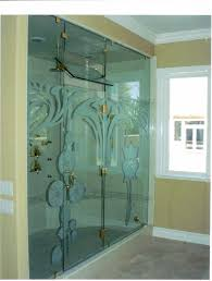 sliding glass door with floral pattern and golden handler placed