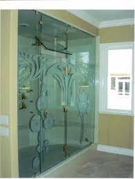 bathroom doors glass sliding glass door with floral pattern and golden handler placed