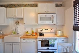 adding beadboard to kitchen cabinets kitchen white stained wooden beadboard backsplash black