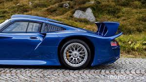 1990 porsche 911 blue porsche 911 gt1 poses in the alps