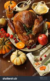 thanksgiving dinner table setting roasted turkey stock photo