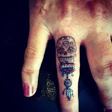 collection of 25 sugar skull on finger