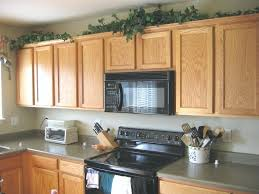 Area Above Kitchen Cabinets Space Above Kitchen Cabinets New Simple Decorating Ideas For