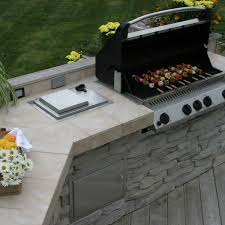 Outside Kitchen Design Stone And Tile Outdoor Kitchen On Wood Deck Archadeck Outdoor Living
