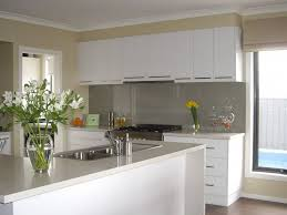 Stainless Steel Kitchen Backsplash by Painted Kitchen Cabinets With White Appliances And Wall Mounted