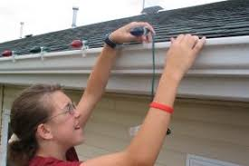 people who hang christmas lights christmas lighting safety trinity safety group