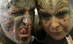 forked tongues and tattooed eyeballs should body modification be
