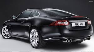 jaguar cars 2010 jaguar xkr back pose in black wallpaper