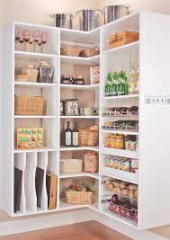 corner white wooden kitchen pantry cabinet having many white