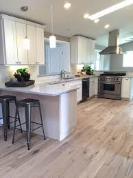 oak kitchen cabinets with oak flooring white oak hardwood flooring bigger than the three of us
