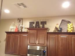 decorating ideas above kitchen cabinets decorating ideas above kitchen cabinets home design inspiration