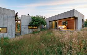 tiny concrete bunker opens to reveal a story home pics with