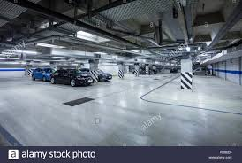 underground parking garage stock photos underground parking parking garage underground interior with a few parked cars stock image