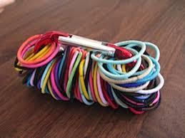 hair elastics store hair ties on a carabiner