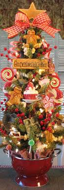 kitchen christmas tree ideas primitive gingerbread cookie baking tree in red colander w lights