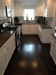 kitchens with grey wood floors and wood cabinets wood floors White Kitchen Cabinets With Black Granite