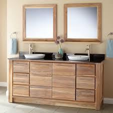 bahtroom usual closet beside dark brown teak bathroom cabinets