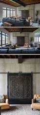 best 25 modern living rooms ideas on pinterest modern decor in this modern living room artistic carved wood panels on a simple metal track hide