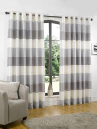 modern clean cut rio ready made eyelet lined curtains silver in polyester stunning style and superb value