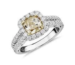 cushion cut yellow diamond split shank ring in 18k white and