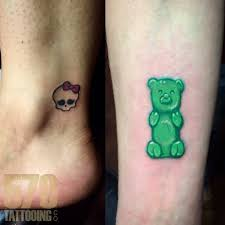 breandan small walk in tattoos gummy bear skull tattoo small tattoo
