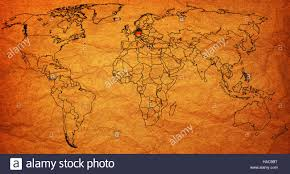 World Map Germany by Germany Flag On Old Vintage World Map With National Borders Stock