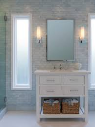 a white porcelain tile floor and iridescent tile walls create a