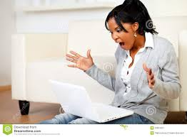 surprised young woman browsing the internet royalty free stock