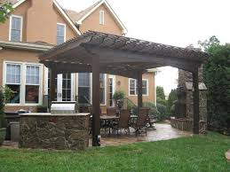 Large Pergola Designs by Large Wooden Pergola Ties Together Patio Design Ideas