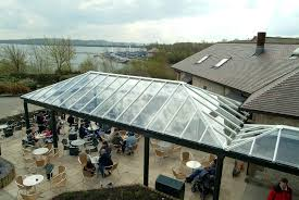 outdoor seating area with commercial conservatory roof simply