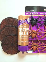 diy stenciled spider web ornaments for a spooky themed