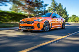 bright orange cars kia brings two modified stinger gt show cars to sema motor trend