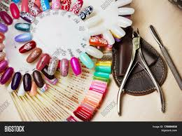 table full of manicure utensils manicure tools nail polish