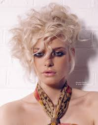short blonde hairstyle with curls and tendrils