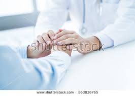 Doctor Comforting Patient Male Doctor Comforting Patient Consulting Room Stock Photo