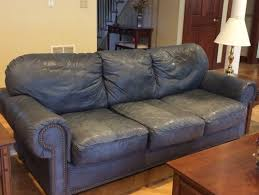 Worn Leather Sofa Does This Leather Sofa Look Tastefully Aged Or Trashed