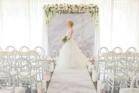 picture of pink marble wedding backdrop aisle runner and floral decor