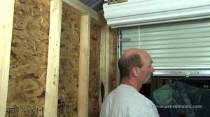 Overhead Shed Doors How To Build A Shed Part 5 Installing A Metal Roll Up Door