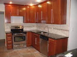 tile floors brown wood kitchen cabinets types of electric ranges