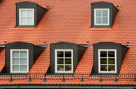 Gabled Dormer Red Tile Roof And Gabled Dormer Windows On Building In Munich