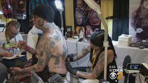 artist aims to break guinness non stop tattooing record cbs