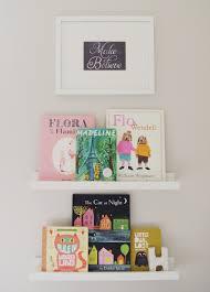 children u0027s books displayed on ikea photo ledges nursery