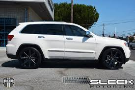 white jeep black rims ride in style with this jeep grand cherokee with dub wheels