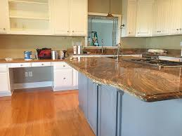 blue kitchen cabinets with granite countertops painting cabinets before or after changing the backsplash