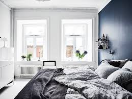 dreamy scandi apartment with a stunning deep blue bedroom daily