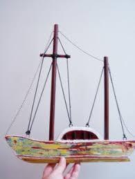 wooden sailboat colourful sailboat of wood metal arktosart